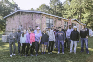 the group of nineteen volunteers who helped renovate the Earp home.