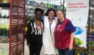 the executive director of onecompassion with lowe's employees who donated to the holiday ministry.